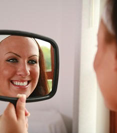 Patient smiling after a dental hygiene cleaning at Southdown Dental